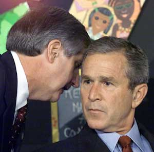 Andrew Card whispers into Bush's ear